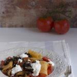 Pasta al sugo con melanzane e stracciatella